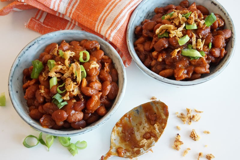 bowls of baked beans with spoon