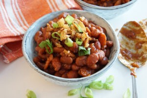 bowl of baked beans with spoon